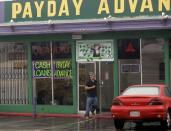 FILE - In this Thursday, Aug. 3, 2006, file photo, The exterior of a Payday Advance store is seen in Oceanside, Calif. California created what supporters called its own nation-leading, state-level version of the federal Consumer Financial Protection Bureau after critics said the Trump administration significantly weakened national protections, Friday, Sept. 25, 2020. The legislation that Gov. Gavin Newsom signed into law changes the existing Department of Business Oversight into the Department of Financial Protection and Innovation in what proponents said is the first such move by any state. (AP Photo/Lenny Ignelzi, File)