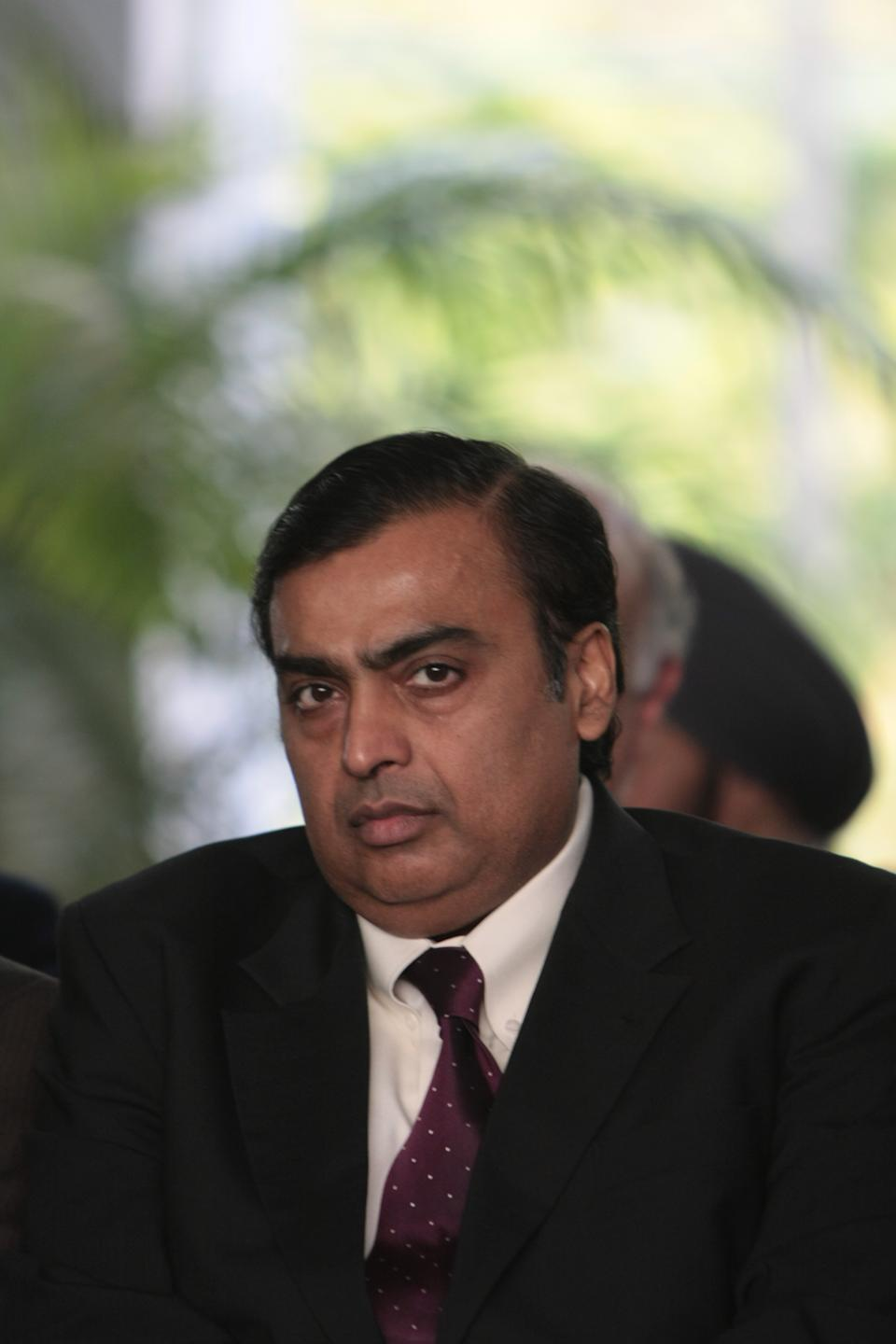 Indian billionaire business magnate Mukesh Ambani, along with his brother Anil Ambani, inherited the Reliance Group conglomerate from the founder, his father Dhirajlal Hirachand Ambani. Mukesh took the reins of the company with his brother Anil in 1985, and the brothers inherited the business in 2002 when their father died. But the group was split in 2005 after the siblings fell out. On 6 July 2002, Mukesh's father died after suffering a second stroke, which elevated tensions between the brothers as Dhirubhai had not left a will for the distribution of the empire in 2004. Their mother intervened to stop the feud, splitting the company into two, Ambani receiving control of Reliance Industries Limited and Indian Petrochemicals Corporation Limited in 2005 and the rest is history with Mukesh growing his business manifold. He is currently the richest man in Asia with a net worth of US$80.5 billion and as of 24 July 2020 he is listed on Forbes as the 5th richest person in the world.
