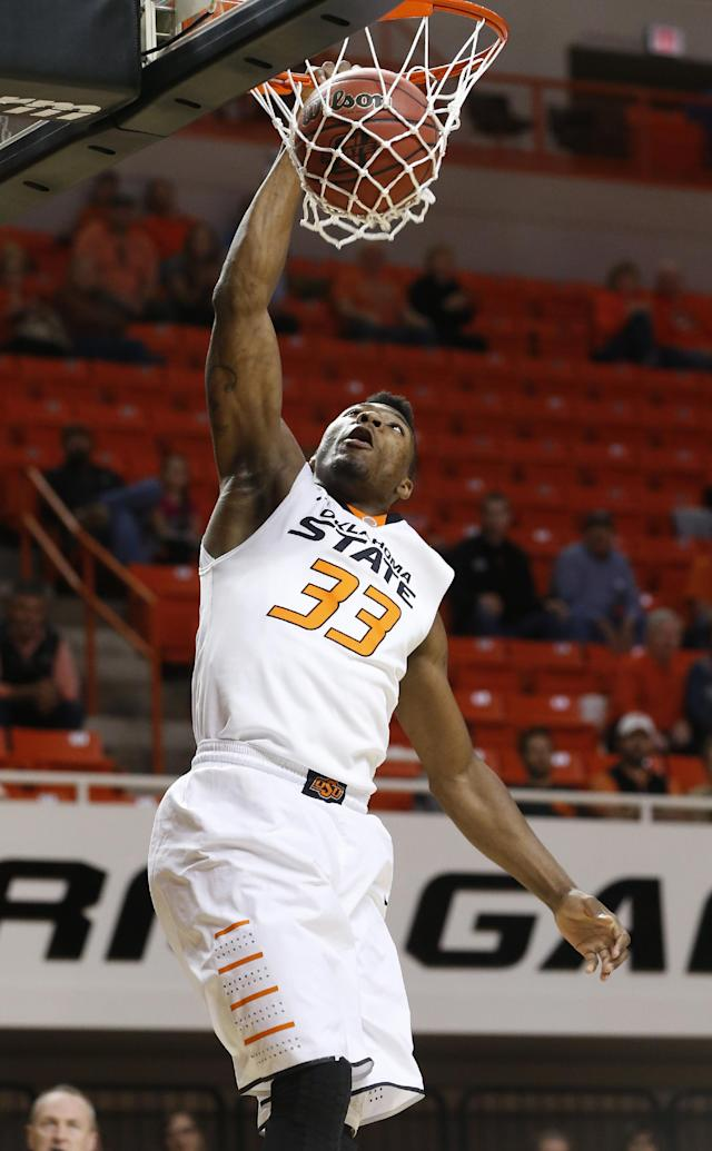 Oklahoma State guard Marcus Smart dunks against Emporia State in the first half of an NCAA college exhibition basketball game in Stillwater, Okla., Friday, Nov. 1, 2013. (AP Photo/Sue Ogrocki)