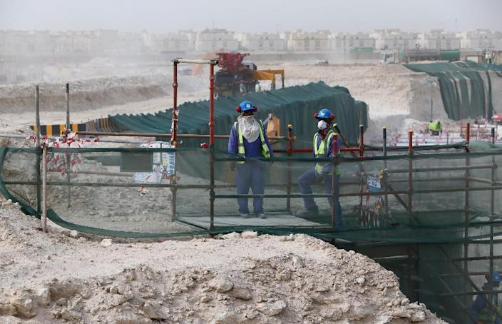 Foreign laborers work at the construction site of the al-Wakrah football stadium in Doha, on May 4, 2015 (AFP Photo/Marwan Naamani)