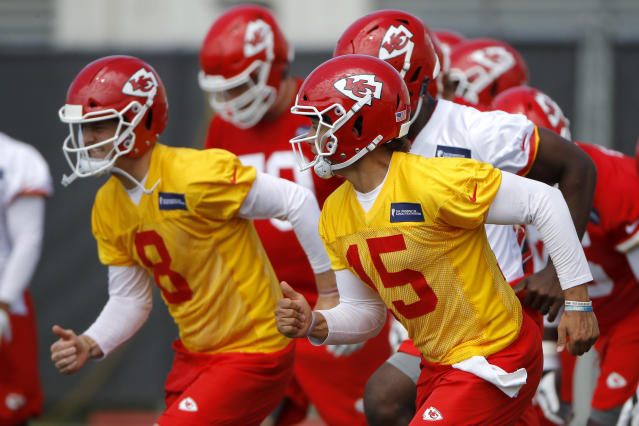 Kansas City Chiefs quarterbacks Patrick Mahomes (15) and Chase Litton run a drill during the NFL football team's organized activities Thursday, May 31, 2018, in Kansas City, Mo. (AP Photo/Charlie Riedel)