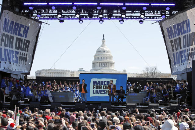 "Lin-Manuel Miranda, left, and Ben Platt perform ""Found Tonight"" during the ""March for Our Lives"" rally in support of gun control, Saturday, March 24, 2018, in Washington. (AP Photo/Alex Brandon)"