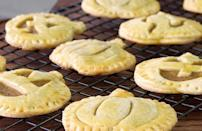 """<p>Baking ahead of time will allow you to make a variety of sweets, like these pumpkin pie cookies. When you do make these pumpkin-shaped treats, make sure you flour everything, even the cookie-cutter — it's a <a href=""""https://www.thedailymeal.com/cook/genius-hacks-amateur-baker?referrer=yahoo&category=beauty_food&include_utm=1&utm_medium=referral&utm_source=yahoo&utm_campaign=feed"""" rel=""""nofollow noopener"""" target=""""_blank"""" data-ylk=""""slk:hack every beginner baker should know"""" class=""""link rapid-noclick-resp"""">hack every beginner baker should know</a>.</p> <p><a href=""""https://www.thedailymeal.com/recipes/pumpkin-pie-cookies-recipe-0?referrer=yahoo&category=beauty_food&include_utm=1&utm_medium=referral&utm_source=yahoo&utm_campaign=feed"""" rel=""""nofollow noopener"""" target=""""_blank"""" data-ylk=""""slk:For the Pumpkin Pie Cookies recipe, click here."""" class=""""link rapid-noclick-resp"""">For the Pumpkin Pie Cookies recipe, click here.</a></p>"""