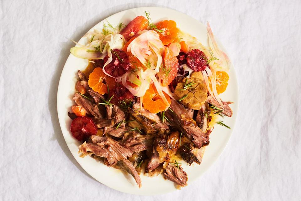 """The richness of lamb pairs nicely with a crisp, bright fennel and orange salad. To make the evening go more smoothly, roast the lamb a day ahead, then rewarm it during the first part of your seder. <a href=""""https://www.epicurious.com/recipes/food/views/lamb-shoulder-with-citrus-fennel-salad?mbid=synd_yahoo_rss"""" rel=""""nofollow noopener"""" target=""""_blank"""" data-ylk=""""slk:See recipe."""" class=""""link rapid-noclick-resp"""">See recipe.</a>"""