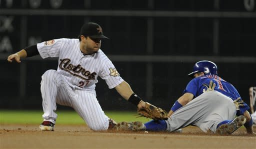 Chicago Cubs' Tony Campana (1) steals second base before being tagged by Houston Astros' Jose Altuve (27) in the first inning of a baseball game, Monday, May 21, 2012, in Houston. (AP Photo/Pat Sullivan)