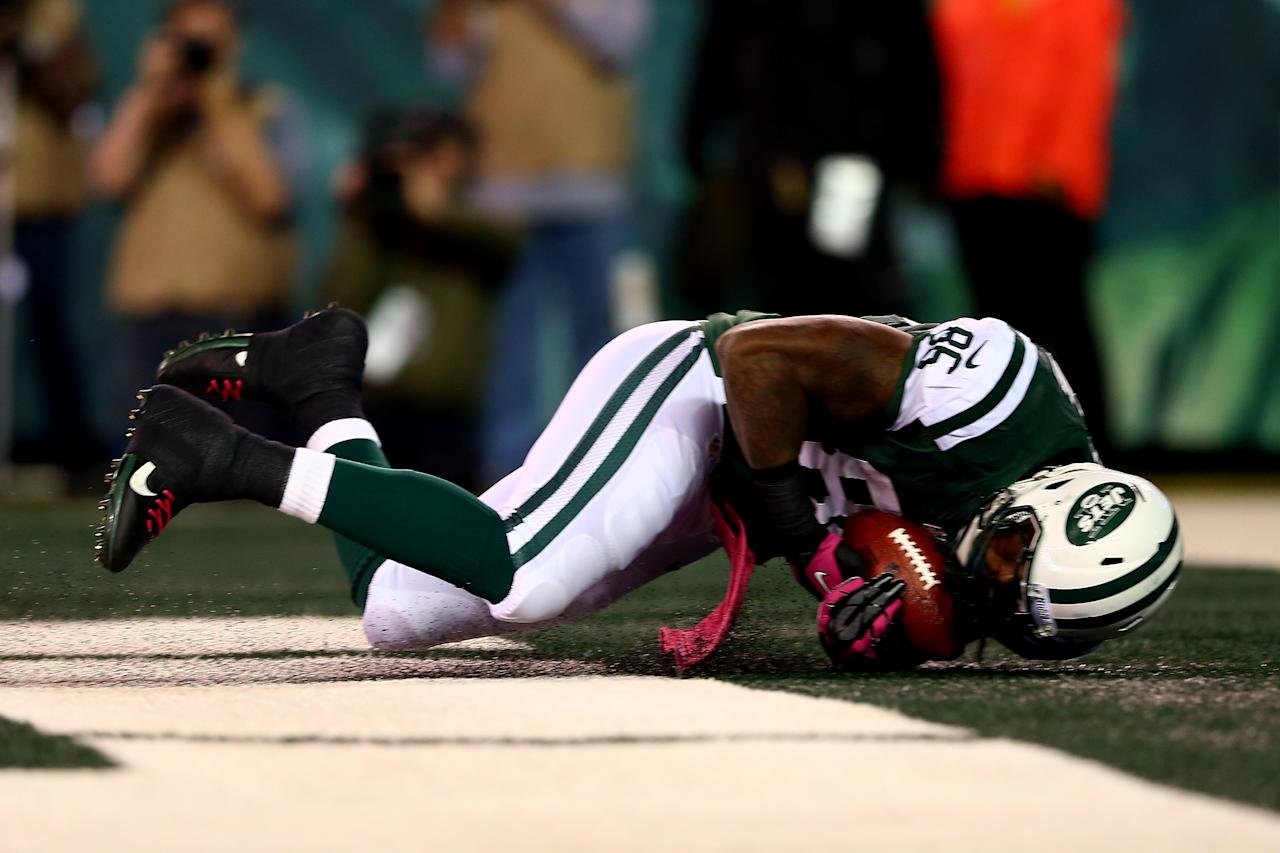 EAST RUTHERFORD, NJ - OCTOBER 08:  Jeff Cumberland #86 of the New York Jets catches a 27-yard touchdown reception in the first quarter against the Houston Texans at MetLife Stadium on October 8, 2012 in East Rutherford, New Jersey.  (Photo by Elsa/Getty Images)