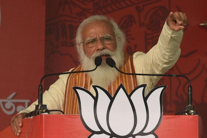"""Prime Minister Narendra Modi addresses a public rally for the West Bengal Assembly Election on April 12, 2021 in the North 24 Parganas district, India.<span class=""""copyright"""">Samir Jana/Hindustan Times via Getty Images</span>"""