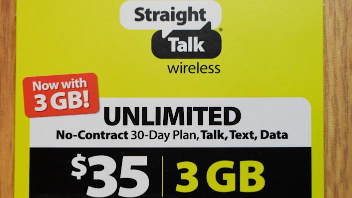 Syracuse, New York, USA - February 13, 2020: Prepaid no-contract mobile phone service plan card from Straight Talk Wireless sold by Walmart with unlimited talk, text, and data.