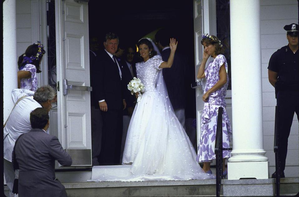 <p>Caroline Kennedy gives photographers gathered outside of the church a final wave before walking down the aisle with her uncle, Ted Kennedy. The former First Daughter married Edwin Schlossberg on July 19, 1986. </p>