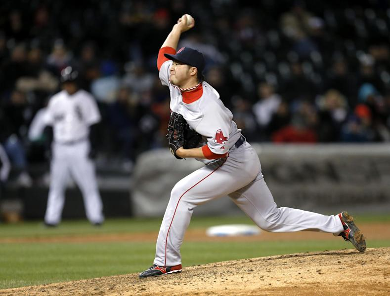 Boston Red Sox relief pitcher Junichi Tazawa delivers during the seventh inning of a baseball game against the Chicago White Sox on Tuesday, April 15, 2014, in Chicago. (AP Photo/Charles Rex Arbogast)