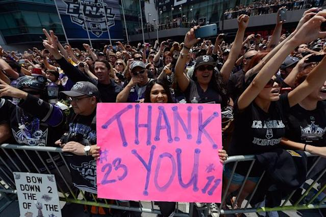 LOS ANGELES, CA - JUNE 14: Fans cheer for the Los Angeles Kings team menbers during the Stanley Cup victory parade on June 14, 2012 in Los Angeles, California. The Kings are celebrating their first NHL Championship in the team's 45-year-old franchise history. (Photo by Kevork Djansezian/Getty Images)