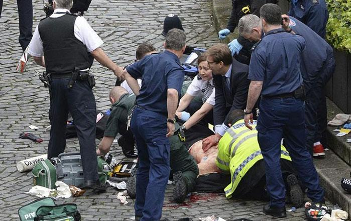 Paramedics working to resuscitate a man on Westminster Bridge. Photo: AAP