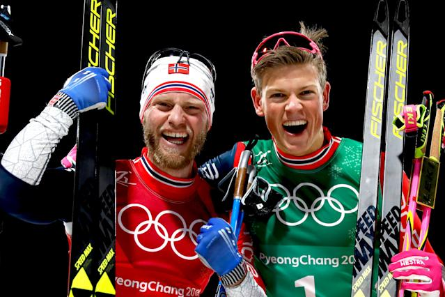 <p>Norway's Martin Johnsrud Sundby and Johannes Hoesflot Klaebo celebrate their gold win in the Men's Cross-Country Team Sprint Free Final at the Alpensia cross country ski centre during the Pyeongchang 2018 Winter Olympic Games on February 21, 2018.<br> (Photo by Odd Andersen/AFP/Getty Images) </p>