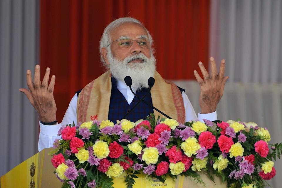 Indian Prime Minister Narendra Modi gestures as he addresses a public meeting at Jerenga Pathar in Sivasagar district of India's Assam state on January 23, 2021. (Photo by Biju BORO / AFP) (Photo by BIJU BORO/AFP via Getty Images)