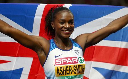 FILE PHOTO: 2018 European Championships - Women's 200 Meters, Final - Olympic Stadium, Berlin, Germany - August 11, 2018 - Dina Asher-Smith of Britain celebrates after winning a gold medal. REUTERS/Michael Dalder/File Photo