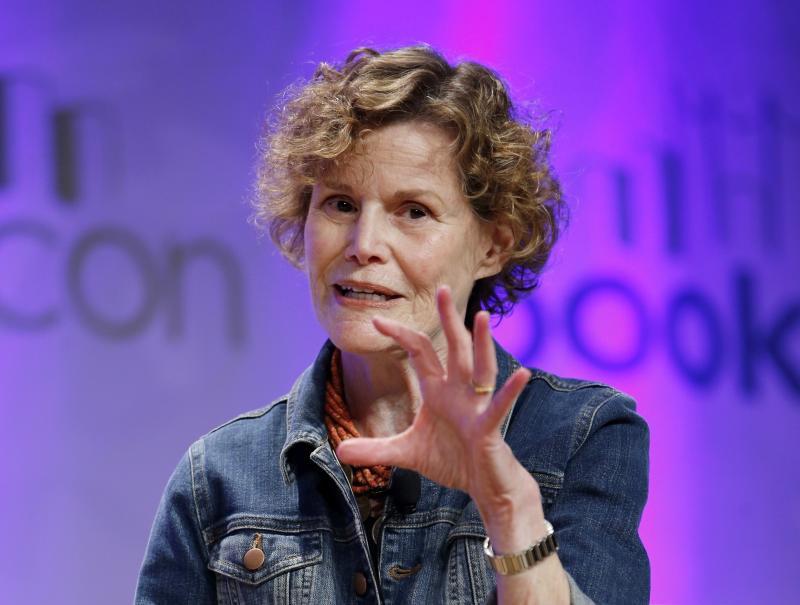 """FILE - In this May 31, 2015, photo, author Judy Blume speaks about her new book, """"In the Unlikely Event,"""" her first novel for adults in 17 years, at BookCon in New York. """"Are You There God? It's Me, Margaret"""" and Hollywood is calling. Judy Blume has at long last agreed to a feature film adaptation of her seminal young adult novel from 1970.  (AP Photo/Kathy Willens, File)"""