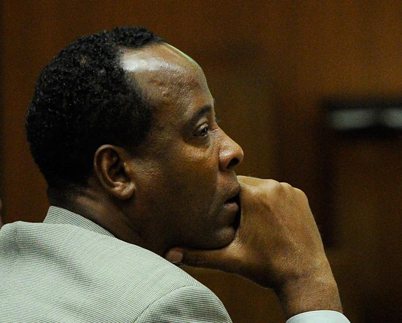 FILE - In a Thursday, Nov. 3, 2011 file photo, Dr. Conrad Murray listens as defense attorney Ed Chernoff, not pictured, gives the defense's closing arguments during the final stage of Conrad Murray's defense in his involuntary manslaughter trial in the death of singer Michael Jackson at the Los Angeles Superior Court in Los Angeles, Calif. The juryis set to resume deliberations Monday, Nov. 7, 2011 after spending their first day in discussions Friday without reaching a verdict.   (AP Photo/Kevork Djansezian, Pool, File)