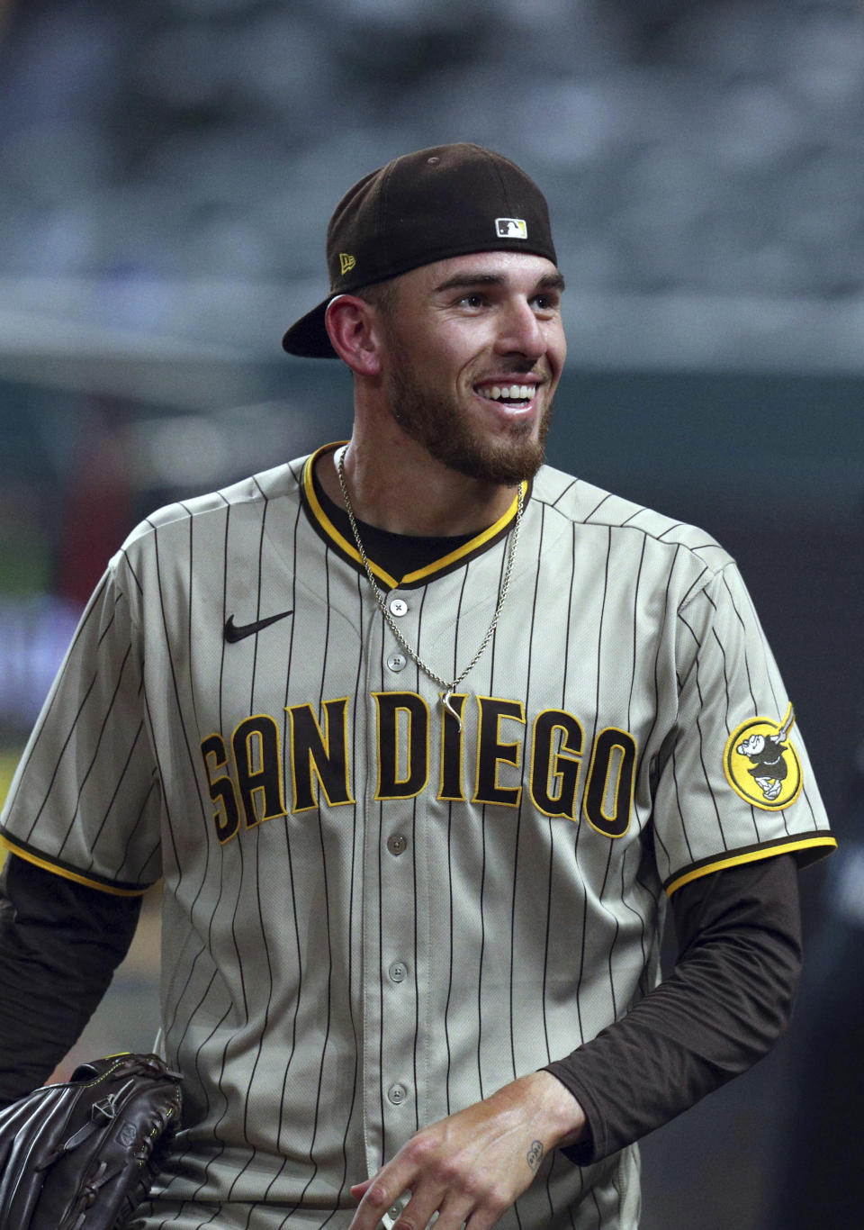 San Diego Padres starting pitcher Joe Musgrove smiles while looking to fans in the stands after pitching a no-hitter against the Texas Rangers in a baseball game Friday, April 9, 2021, in Arlington, Texas. (AP Photo/Richard W. Rodriguez)