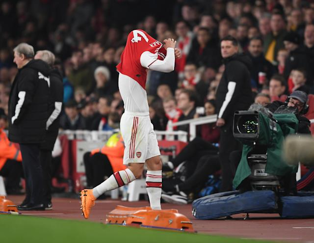 Arsenal captain Granit Xhaka removes his shirt after leaving the pitch. (Photo by Stuart MacFarlane/Arsenal FC via Getty Images)