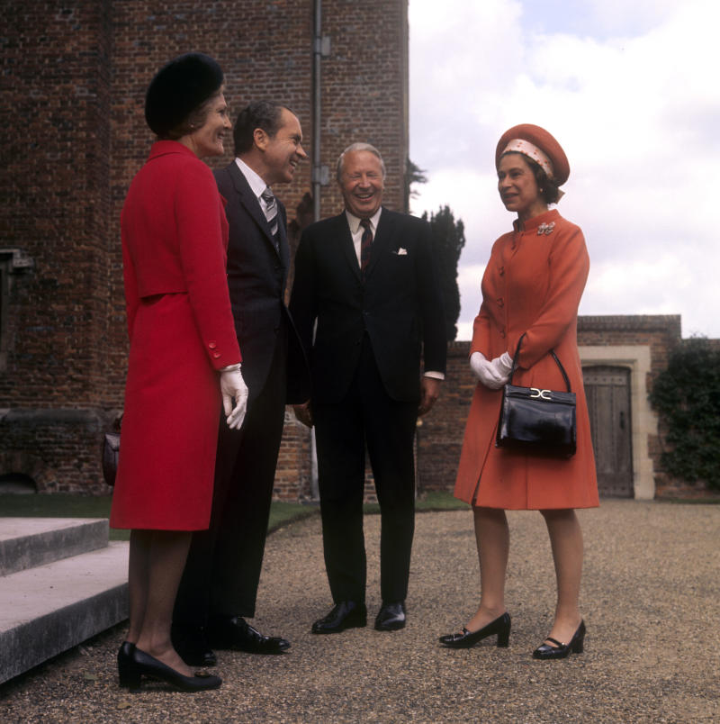 The Queen meeting US President Richard Nixon in 1970, holding her Launer bag. [Photo: PA]