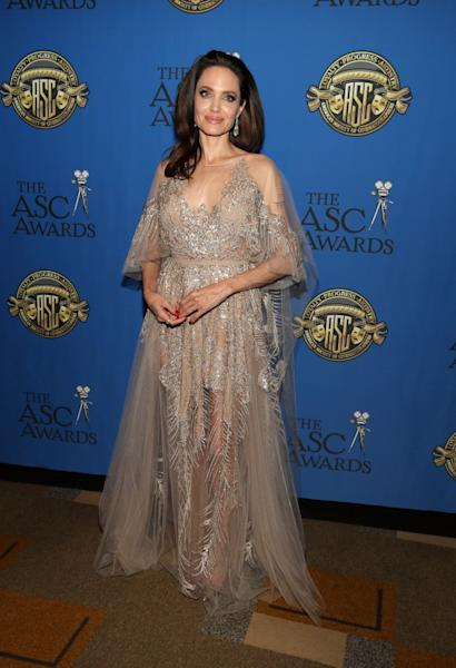 The actress and director went solo for the night, but wowed on the red carpet in an ethereal gown.