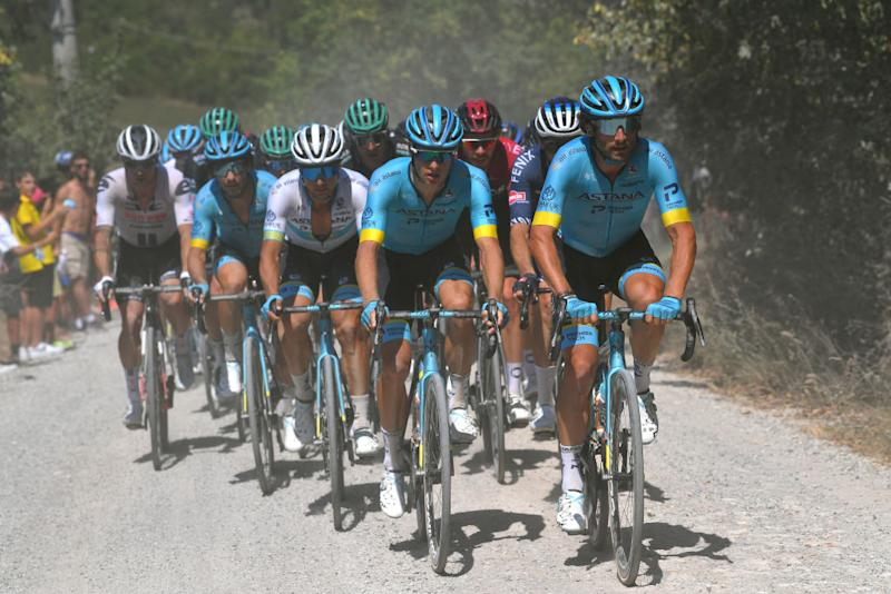 SIENA ITALY AUGUST 01 Manuele Boaro of Italy and Astana Pro Team Jakob Fuglsang of Denmark and Astana Pro Team Alexey Lutsenko of Kazakhstan and Astana Pro Team Dust Gravel Strokes during the Eroica 14th Strade Bianche 2020 Men a 184km race from Siena to SienaPiazza del Campo StradeBianche on August 01 2020 in Siena Italy Photo by Tim de WaeleGetty Images