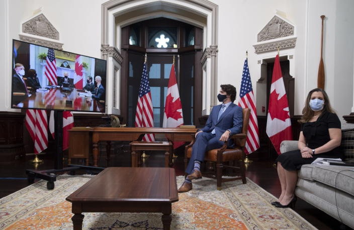 Canadian Prime Minister Justin Trudeau and Deputy Prime Minister and Minister of Finance Chrystia Freeland watch television screens as they meet virtually with United States President Joe Biden from his office on Parliament Hill in Ottawa, Ontario, Tuesday, Feb. 23, 2021. (Adrian Wyld/The Canadian Press via AP)