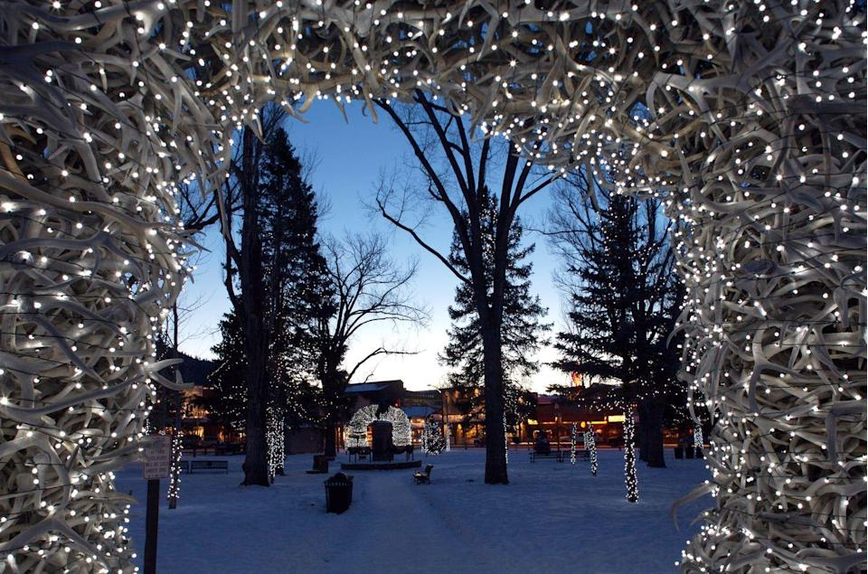 """<p>No town lights up for the holidays quite like <a href=""""https://go.redirectingat.com?id=74968X1596630&url=https%3A%2F%2Fwww.tripadvisor.com%2FTourism-g60491-Jackson_Jackson_Hole_Wyoming-Vacations.html&sref=https%3A%2F%2Fwww.countryliving.com%2Flife%2Ftravel%2Fg2829%2Fbest-christmas-towns-in-usa%2F"""" rel=""""nofollow noopener"""" target=""""_blank"""" data-ylk=""""slk:Jackson"""" class=""""link rapid-noclick-resp"""">Jackson</a>. The town at the base of the Tetons has a spectacular town square any time of the year, with monumental arches of elk antlers at the four corners. But around the holidays, the arches are wrapped in strings of lights to illuminate the nights with a festive glow. Stick around until New Year's Eve if you want to see the torch parade of ski instructors snaking down the mountain at the town's two ski resorts.</p><p><strong><a class=""""link rapid-noclick-resp"""" href=""""https://go.redirectingat.com?id=74968X1596630&url=https%3A%2F%2Fwww.tripadvisor.com%2FTourism-g60491-Jackson_Jackson_Hole_Wyoming-Vacations.html&sref=https%3A%2F%2Fwww.countryliving.com%2Flife%2Ftravel%2Fg2829%2Fbest-christmas-towns-in-usa%2F"""" rel=""""nofollow noopener"""" target=""""_blank"""" data-ylk=""""slk:PLAN YOUR TRIP"""">PLAN YOUR TRIP</a></strong></p>"""