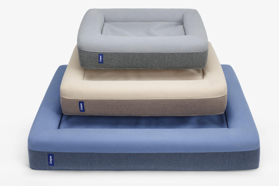 This photo provided by Casper shows an assortment of the company's pet beds in different colors and sizes. The beds are made of supportive, comforting foam with a durable, machine-washable outer cover that sheds fur and withstands bites and scratches. No longer are furniture companies content to offer you staples like a sofa, easy chair and bed. Now they have those items for your pet, too, designed not to clash with the rest of your decor. Pottery Barn, Crate and Barrel, Ikea, Casper mattresses and other popular furniture purveyors have lines for pets, often in styles that complement their human-size living room furniture. (Casper via AP)
