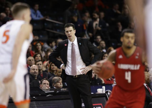 Louisville head coach David Padgett watches his team play during the first half of an NCAA college basketball game against Virginia in the quarterfinal round of the Atlantic Coast Conference tournament Thursday, March 8, 2018, in New York. (AP Photo/Frank Franklin II)
