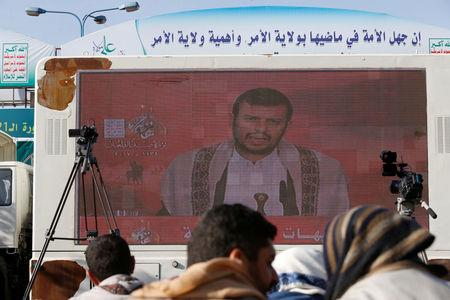 FILE PHOTO: Leader of the Shi'ite Houthi movement, Abdul-Malik Badruddin al-Houthi, addresses supporters via a screen during a demonstration to mark the Ashura holy day in Sanaa