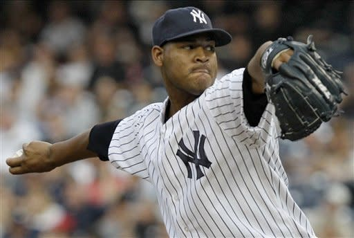 New York Yankees starting pitcher Ivan Nova delivers in the first inning against the Chicago White Sox during their baseball game at Yankee Stadium in New York, Thursday, June 28, 2012. (AP Photo/Kathy Willens)