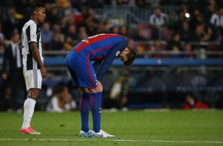 Barcelona's Gerard Pique looks dejected