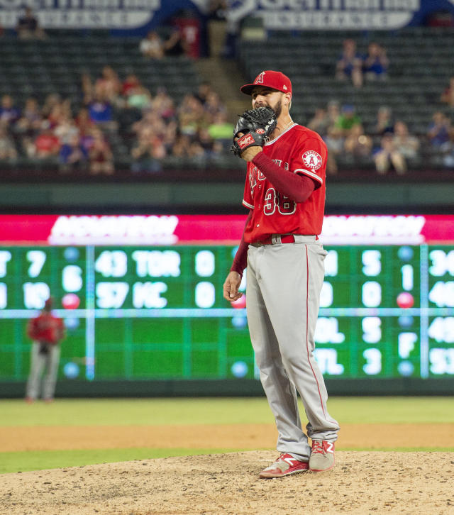 Los Angeles Angels relief pitcher Justin Anderson reacts after issuing a bases-loaded walk to Texas Rangers' Shin-Soo Choo which scored Jurickson Profar to tie the score during the eighth inning of a baseball game, Thursday, Aug. 16, 2018, in Arlington, Texas. Texas won 8-6. (AP Photo/Jeffrey McWhorter)