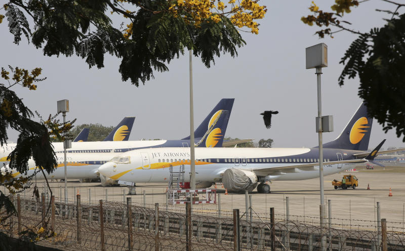 FILE- In this Monday, April 15, 2019 file photo, Jet Airways aircrafts are seen parked at Chhatrapati Shivaji Maharaj International Airport in Mumbai. Jet Airways, once India's largest airline, says it is temporarily suspending all operations after failing to raise enough money to run its services. (AP Photo/Rafiq Maqbool, File)