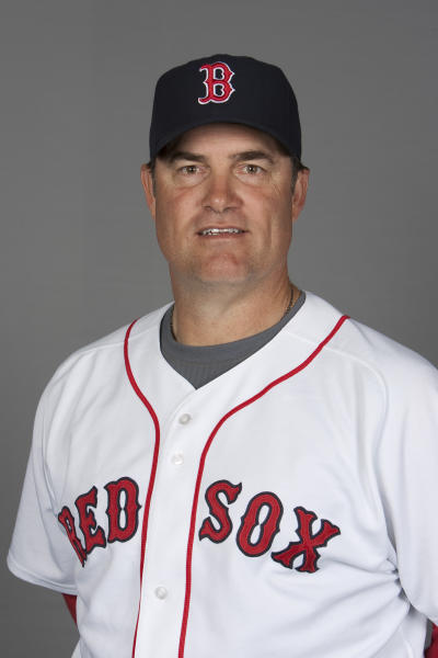 FILE - This 2010, file photo shows Boston Red Sox pitching coach John Farrell. The Red Sox are preparing to announce that John Farrell will be their new manager, according to a baseball official with knowledge of the deal to bring the former Boston pitching coach back one year after the ballclub first tried to give him the top job. The announcement was delayed by the unusual logistics of hiring a manager under contract with another team, the official said, speaking on the condition of anonymity because the final procedural steps had not been cleared. But the three-year deal to replace Bobby Valentine could be announced as soon as Sunday, Oct. 21, 2012 the official said. (AP Photo/Nati Harnik, File)