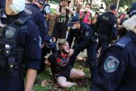 A person is arrested by police during an Australia Day protest in Sydney
