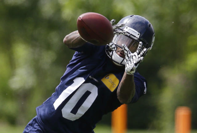 Seattle Seahawks rookie wide receiver Paul Richardson catches a pass during an NFL football organized team activity, Tuesday, May 27, 2014, in Renton, Wash. (AP Photo/Ted S. Warren)