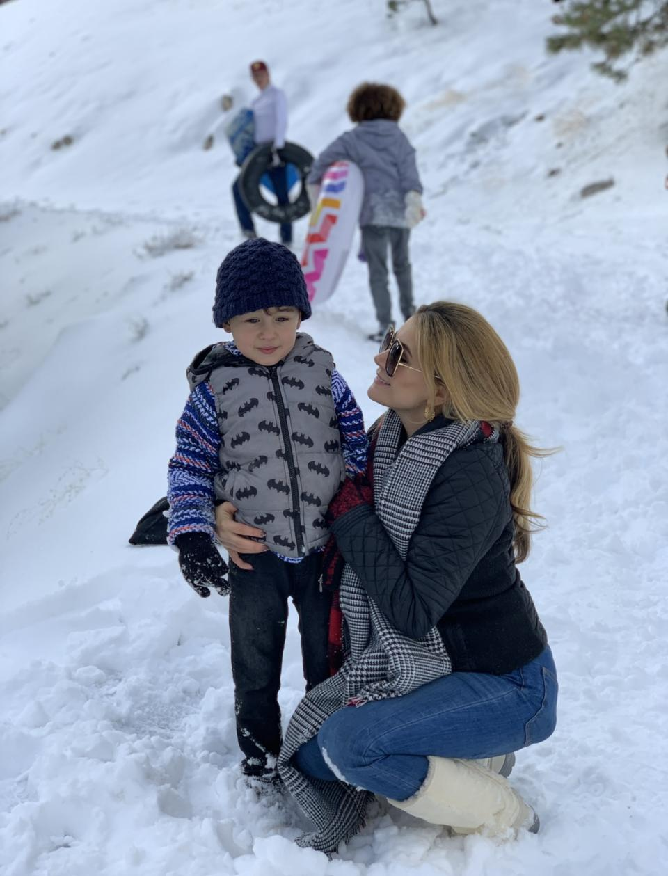 Kristen with son at Christmas snow