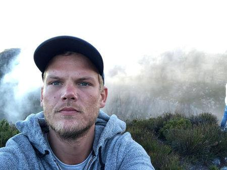 Swedish musician, DJ, remixer and record producer Avicii takes a selfie on Table Mountain