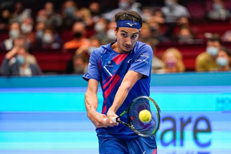 Final chance: Italy's Lorenzo Sonego returns the ball to Dan Evans