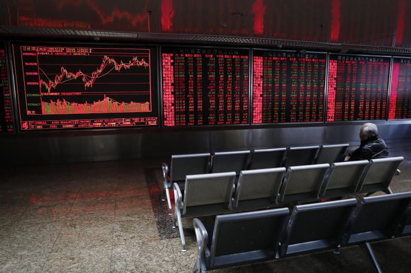 A Chinese investor monitors stock prices at a brokerage house in Beijing, Thursday, Nov. 28, 2019. Asian shares were mostly lower on Thursday after President Donald Trump signed a bill expressing support for human rights in Hong Kong. (AP Photo/Andy Wong)