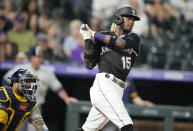 Colorado Rockies' Raimel Tapia watches his RBI single off Milwaukee Brewers relief pitcher Eric Yardley during the sixth inning of a baseball game Thursday, June 17, 2021, in Denver. (AP Photo/David Zalubowski)