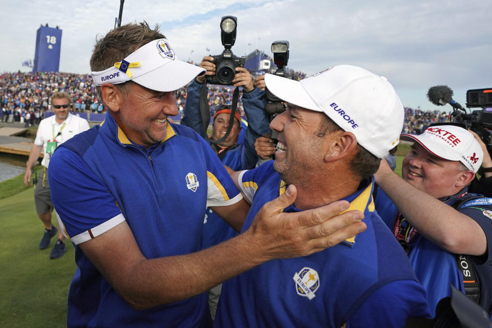 FILE - In this Sept. 30, 2018, file photo, Europe's Sergio Garcia, right, celebrates with Ian Poulter after Europe won the Ryder Cup on the final day of the 42nd Ryder Cup at Le Golf National in Saint-Quentin-en-Yvelines, outside Paris, France. The pandemic-delayed 2020 Ryder Cup returns the United States next week at Whistling Straits along the Wisconsin shores of Lake Michigan. (AP Photo/Laurent Cipriani, File)