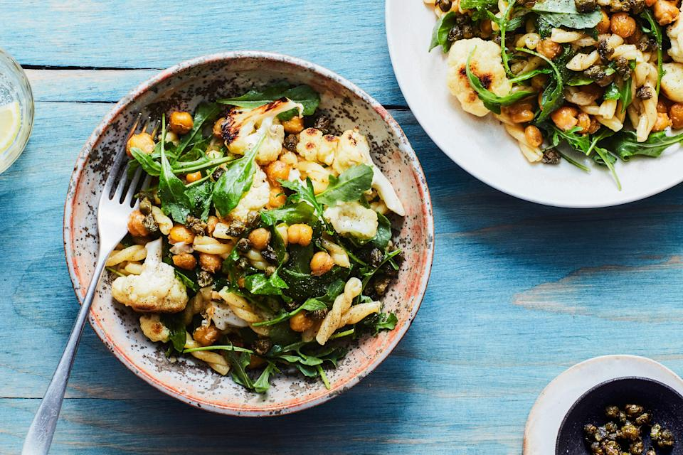 """<h1 class=""""title"""">Chickpea Cauliflower Pasta</h1> <div class=""""caption""""> <a href=""""https://www.epicurious.com/recipes/food/views/lemony-pasta-with-cauliflower-chickpeas-and-arugula?mbid=synd_yahoo_rss"""" rel=""""nofollow noopener"""" target=""""_blank"""" data-ylk=""""slk:This pasta recipe has sautéed cauliflower, chickpeas, and arugula with lots of lemon juice and capers."""" class=""""link rapid-noclick-resp"""">This pasta recipe has sautéed cauliflower, chickpeas, and arugula with lots of lemon juice and capers.</a> </div> <cite class=""""credit"""">Photo by Chelsea Kyle, Prop Styling by Beatrice Chastka, Food Styling by Olivia Mack Anderson</cite>"""