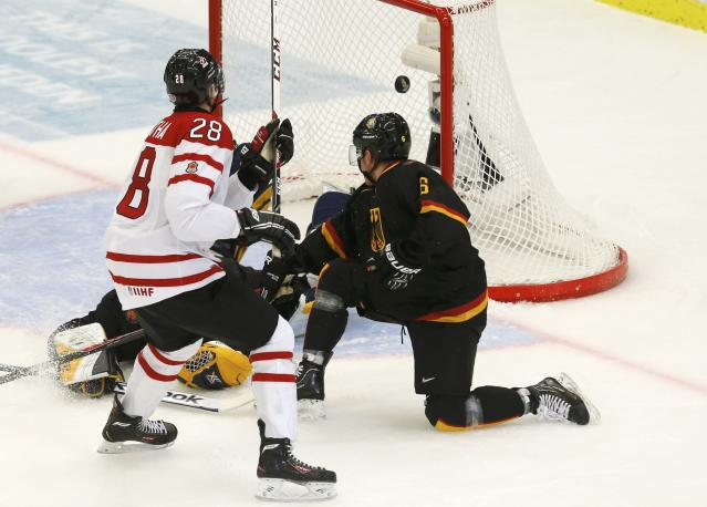 Canada's Anthony Mantha (L) scores on Germany's goalie Marvin Cupper as Germany's Parker Tuomie tries to defend during the first period of their IIHF World Junior Championship ice hockey game in Malmo, Sweden, December 26, 2013. REUTERS/Alexander Demianchuk (SWEDEN - Tags: SPORT ICE HOCKEY)