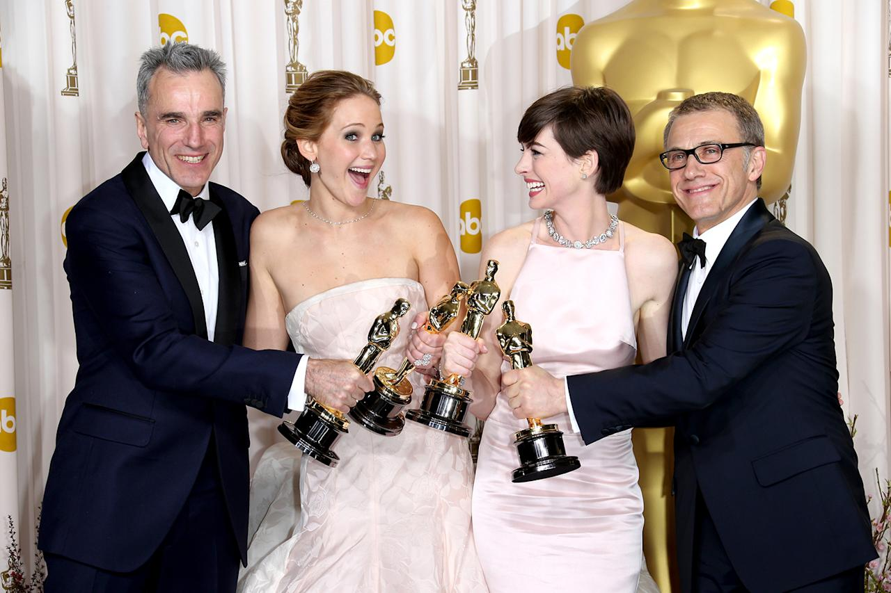 (L-R) Daniel Day-Lewis, Jennifer Lawrence, Anne Hathaway and Christoph Waltz pose in the press room at the 85th Annual Academy Awards at Hollywood & Highland Center on February 24, 2013 in Hollywood, California.