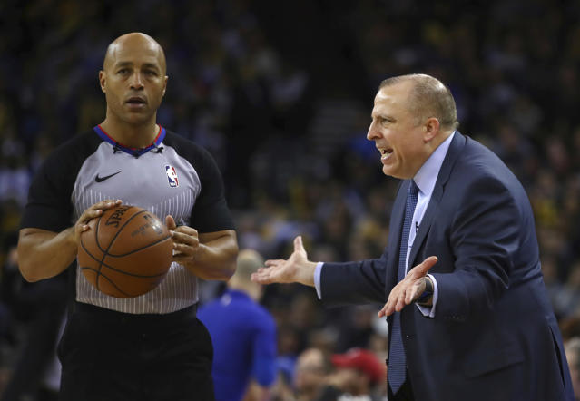 Referee Marc Davis works on his conflict resolution with Timberwolves coach Tom Thibodeau. (AP)
