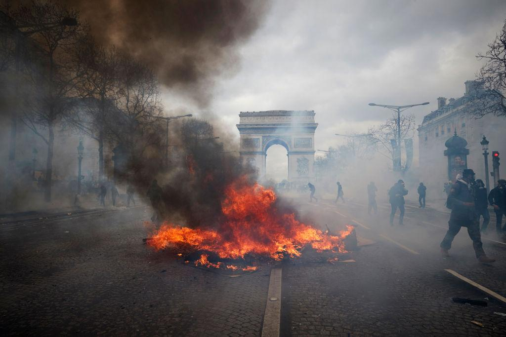 "<p>A burning barricade on the Champs Elysees as Act 18 of protests, presented as an ""ultimatum"" to President Macron, turn violent on the four-month anniversary of the movement on March 16, 2019 in Paris, France. The yellow vests have called for a revival on the occasion of the end of the Macron's 'great national debate', after two months of meetings throughout France, which many yellow vests considered a ""masquerade"". (Photo from Kiran Ridley/Getty Images) </p>"