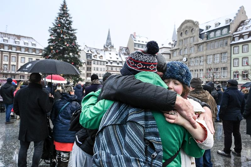 Hundreds of people gathered at the Christmas market in Strasbourg, eastern France, on Sunday to honour the victims of a gunman's shooting spree last week